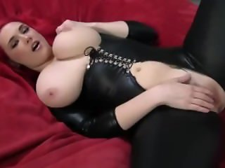 Redhead in black latex