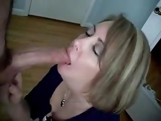 Mature does a blowjob to a guy with a big cock (Not me)