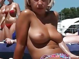 Topless Blonde On The Beach