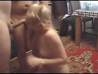 Blone MILF sucks two guys off until they cum in her face