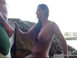Big-tittied chick sucks and fucks on the beach