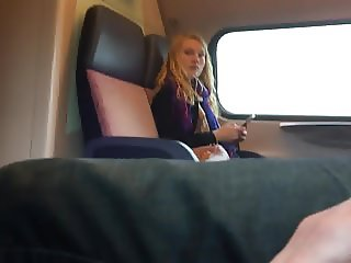 Jerking next to blond girl in train