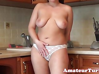 Big titted amateur babe strips in kitchen