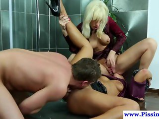 Pissing glamour babes sucking dick in trio