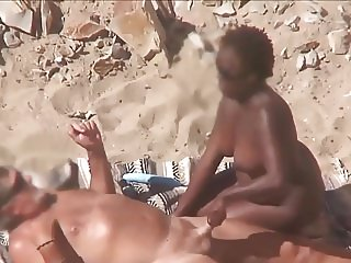 Interracial Mature Beach Couple.avi