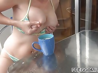 amateur MILF squirting breast milk on the balcony