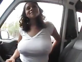 Showing her big tits in the car