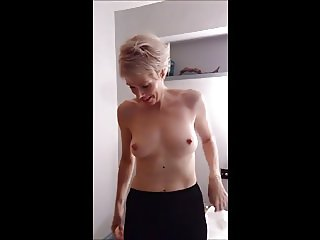 Blonde milf offers slim body and erect nipples to cum over.