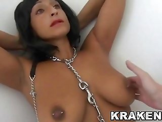 Submissive brunette MILF chained in a BDSM scene
