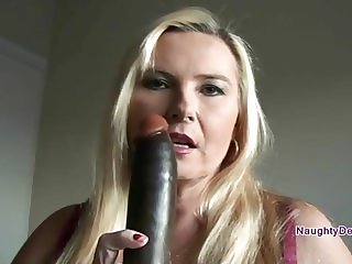 Desiree using a big black dildo on herself
