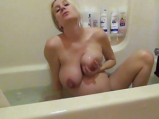 Pregnant belly massage in the shower