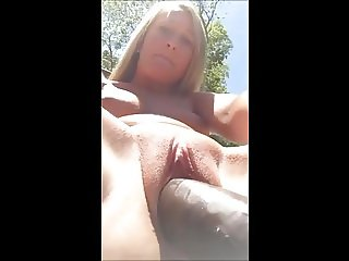 She Dildos Her Pussy Outside