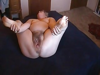Kim Bates strips and toys hairy pussy. Can you help?