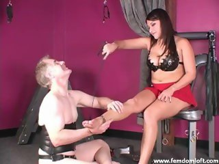Foot slave massaging dominant feet and legs while being punished