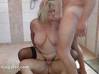 British Milf fucked by two in a wetroom