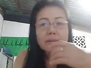 mature thai show tits and pussy