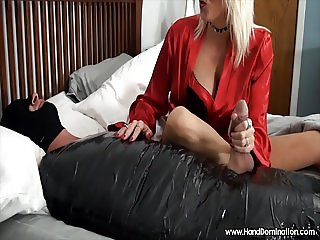 Mature woman has her way with bound man