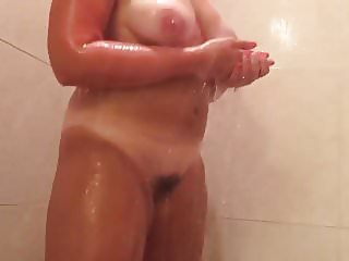 Hairy pussy and big tits showering please comment