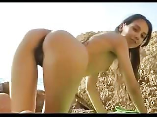 skinny hairy girl plays with herself nude on beach