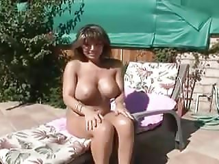 Busty brunette milf blows the pool boy