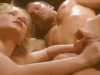An erotically filmed gangbang with a blonde