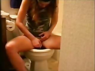Inserting tampon, toilet spy cam