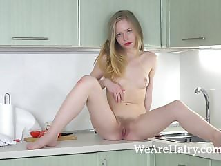 Alexandra strips naked and enjoys her kitchen