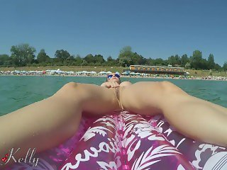 Crazy girlfriend masturbates while nude on a inflatable matress in the sea