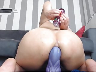 8:15 Squirts Big Dragon Dildo up her ass