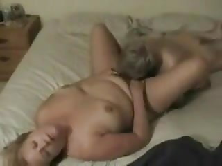 Young boy licking and eating older wife