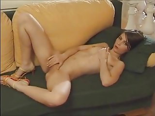 Cute pale brunette strips and plays on the couch