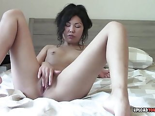 Asian beauty fingering her cunt