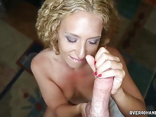 Mature MILF Offers Young Guy A Quick Handjob