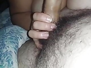 Licking my husband's cock.