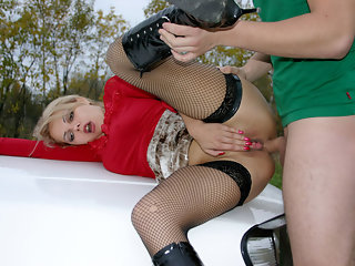 A blonde in laced stockings and boots comes to have sex for money