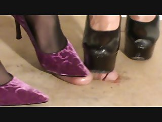 Evey and Mia cock and balls under high heels