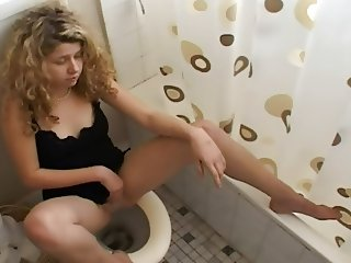 Sitting on the toilet masterbating girl