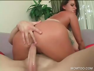 Tattoed MILF riding big phallus