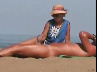 Old MILF Beach Handjob