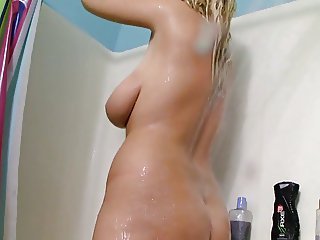 Busty Raquel in the shower