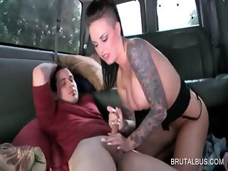 Busty brunette tramp gets cunnilingus in the bus
