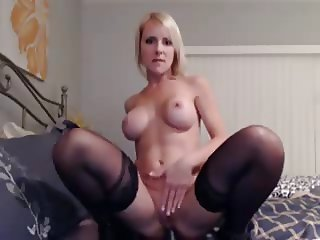milf fucks both holes with her toy