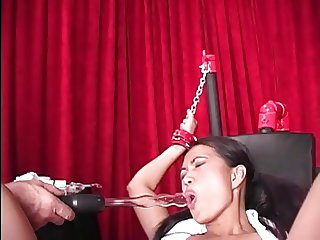 Sexy Asian on bondage table takes pain