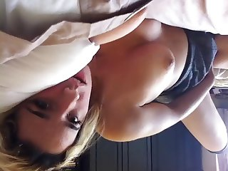 Teen touching and teasing herself.