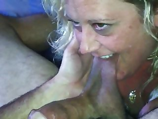 Playing with his balls and cock