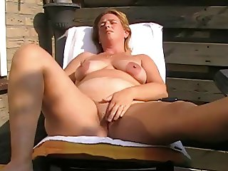 Mature with saggy tits masturbating and toying