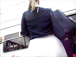 Gorgeous blonde with big round ass in tight white skirt