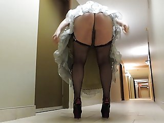Sissy Ray in Silver Evening dress in hotel corridor