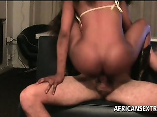 Afro seductress taking white huge phallus from behind