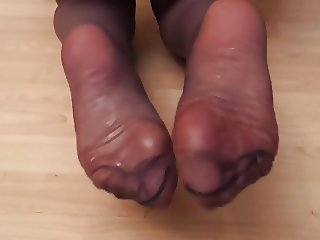 Baby oil and pantyhosed feet